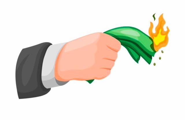 Нарисованная рука держит горящую пачку денег